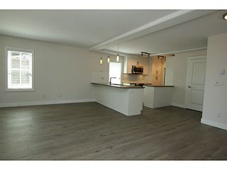 "Photo 3: 101 218 BEGIN Street in Coquitlam: Maillardville House for sale in ""BEGIN SQUARE"" : MLS®# V1132326"