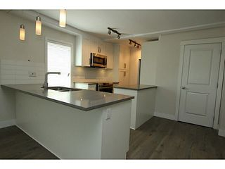 "Photo 5: 101 218 BEGIN Street in Coquitlam: Maillardville House for sale in ""BEGIN SQUARE"" : MLS®# V1132326"