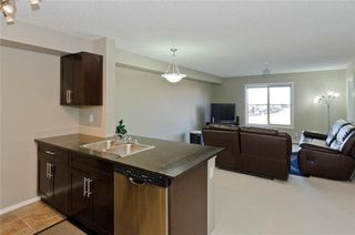 Photo 9: 414 15 SADDLESTONE Way NE in Calgary: Saddle Ridge Condo for sale : MLS®# C4149738