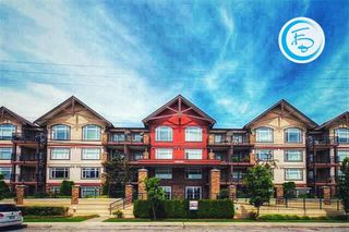 Photo 1: 211 19939 55A AVENUE in Langley: Langley City Condo for sale : MLS®# R2220320