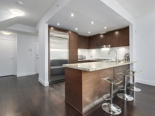 """Photo 3: 105 5958 IONA Drive in Vancouver: University VW Townhouse for sale in """"Argyll House East"""" (Vancouver West)  : MLS®# R2308126"""