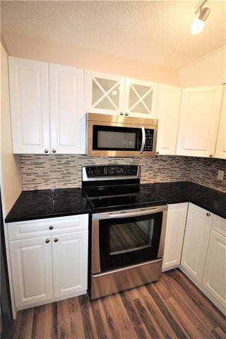 Photo 6: 3631 27A Avenue SE in Calgary: Dover Semi Detached for sale : MLS®# C4220827