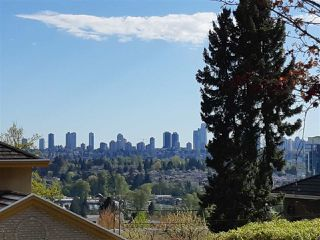 "Photo 1: 6091 GRANT Street in Burnaby: Parkcrest House for sale in ""PARKCREST - KENSINGTON"" (Burnaby North)  : MLS®# R2379467"