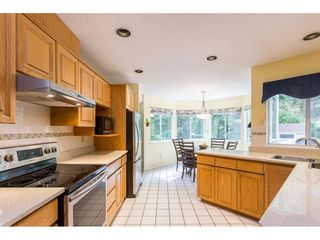 Photo 2: 1307 CAMELLIA Court in Port Moody: Mountain Meadows House for sale : MLS®# R2380794