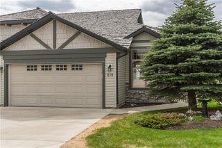 Photo 1: 219 SPRINGBANK Villas SW in Calgary: Springbank Hill Semi Detached for sale : MLS®# A1031788