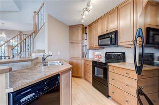 Photo 12: 219 SPRINGBANK Villas SW in Calgary: Springbank Hill Semi Detached for sale : MLS®# A1031788