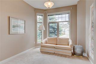 Photo 3: 219 SPRINGBANK Villas SW in Calgary: Springbank Hill Semi Detached for sale : MLS®# A1031788