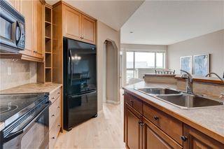 Photo 13: 219 SPRINGBANK Villas SW in Calgary: Springbank Hill Semi Detached for sale : MLS®# A1031788