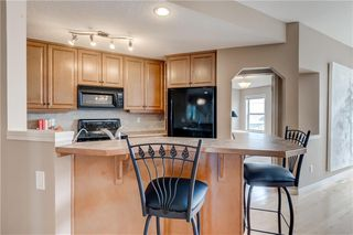Photo 11: 219 SPRINGBANK Villas SW in Calgary: Springbank Hill Semi Detached for sale : MLS®# A1031788