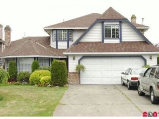 Photo 1: 18592 62ND Avenue in Surrey: Cloverdale BC House for sale (Cloverdale)  : MLS®# F1323524
