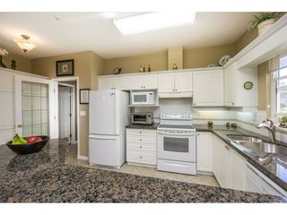 """Photo 9: 65 9025 216 Street in Langley: Walnut Grove Townhouse for sale in """"COVENTRY WOODS"""" : MLS®# R2104028"""