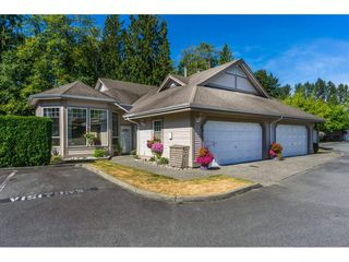 """Photo 1: 65 9025 216 Street in Langley: Walnut Grove Townhouse for sale in """"COVENTRY WOODS"""" : MLS®# R2104028"""