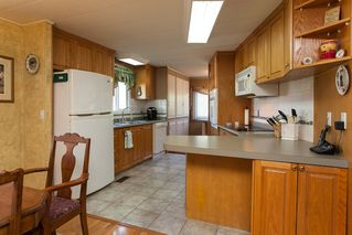 "Photo 2: 134 3665 244 Street in Langley: Otter District Manufactured Home for sale in ""LANGLEY GROVE ESTATES"" : MLS®# R2109959"