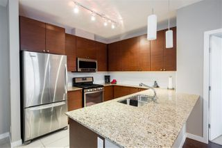 "Photo 2: 418 101 MORRISSEY Road in Port Moody: Port Moody Centre Condo for sale in ""LIBRA AT SUTERBROOK"" : MLS®# R2307652"