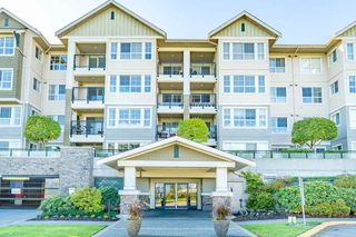 "Main Photo: 420 19673 MEADOW GARDENS Way in Pitt Meadows: North Meadows PI Condo for sale in ""THE FAIRWAYS"" : MLS®# R2316139"