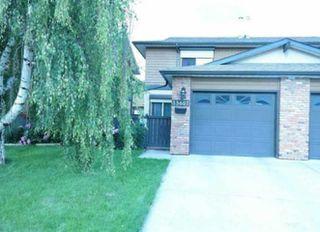 Photo 1: 13607 28 Street in Edmonton: Zone 35 House Half Duplex for sale : MLS®# E4172764