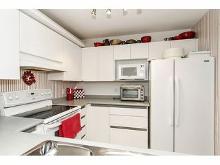 """Photo 9: 211 2960 PRINCESS Crescent in Coquitlam: Canyon Springs Condo for sale in """"JEFFERSON"""" : MLS®# V1046778"""