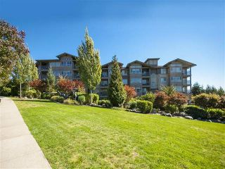 "Photo 1: 418 3110 DAYANEE SPRINGS BL in Coquitlam: Westwood Plateau Condo for sale in ""LEDGEVIEW"" : MLS®# R2118967"