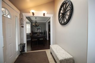 "Photo 2: 4566 206A Street in Langley: Langley City House for sale in ""Mossey Estates"" : MLS®# R2204038"