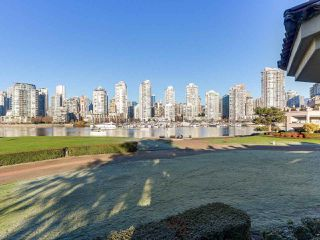 "Photo 1: 219 1869 SPYGLASS Place in Vancouver: False Creek Condo for sale in ""THE REGATTA"" (Vancouver West)  : MLS®# R2327588"