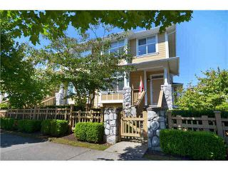 "Photo 1: 961 W 59TH Avenue in Vancouver: South Cambie Townhouse for sale in ""CHURCHILL GARDENS"" (Vancouver West)  : MLS®# R2330817"