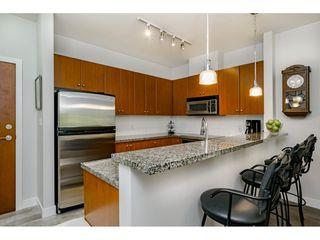 "Photo 3: 210 200 CAPILANO Road in Port Moody: Port Moody Centre Condo for sale in ""SUTER BROOK"" : MLS®# R2374037"