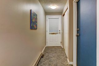 Photo 2: 100 POINT Drive NW in Calgary: Point McKay Row/Townhouse for sale : MLS®# A1013068