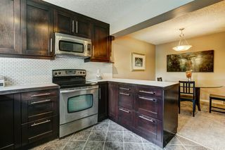 Photo 4: 100 POINT Drive NW in Calgary: Point McKay Row/Townhouse for sale : MLS®# A1013068
