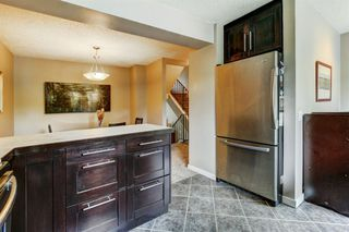 Photo 6: 100 POINT Drive NW in Calgary: Point McKay Row/Townhouse for sale : MLS®# A1013068