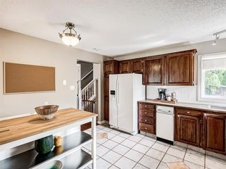 Photo 13: 60 WOODMONT Rise SW in Calgary: Woodbine Detached for sale : MLS®# A1031558