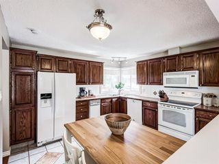 Photo 10: 60 WOODMONT Rise SW in Calgary: Woodbine Detached for sale : MLS®# A1031558