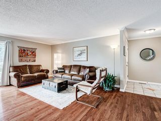 Photo 3: 60 WOODMONT Rise SW in Calgary: Woodbine Detached for sale : MLS®# A1031558