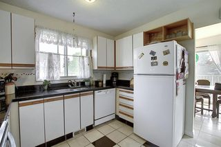 Photo 5: 7011 HUNTERVILLE Road NW in Calgary: Huntington Hills Semi Detached for sale : MLS®# A1035276