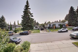 Photo 15: 7011 HUNTERVILLE Road NW in Calgary: Huntington Hills Semi Detached for sale : MLS®# A1035276
