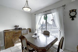 Photo 8: 7011 HUNTERVILLE Road NW in Calgary: Huntington Hills Semi Detached for sale : MLS®# A1035276