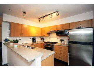 Photo 4: 304 801 KLAHANIE Drive in Port Moody: Port Moody Centre Condo for sale : MLS®# V980794
