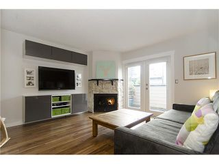 Photo 1: 215 BALMORAL Place in Port Moody: North Shore Pt Moody Townhouse for sale : MLS®# V1055282