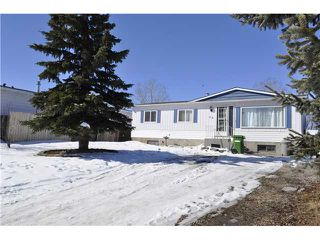 Photo 1: 48 SPRING HAVEN Road SE: Airdrie Residential Detached Single Family for sale : MLS®# C3607940