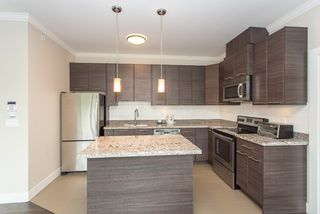 """Photo 4: 401 7377 14TH Avenue in Burnaby: Edmonds BE Condo for sale in """"VIBE"""" (Burnaby East)  : MLS®# R2089853"""