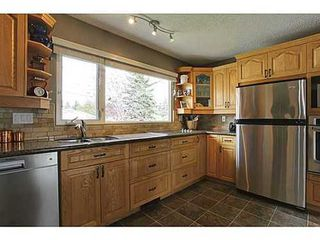 Photo 3: 6135 LONGMOOR Way SW in Calgary: Bi-Level for sale : MLS®# C3584023