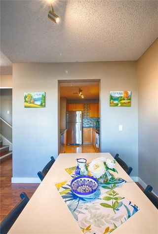Photo 11: 33 3029 RUNDLESON Road NE in Calgary: Rundle Row/Townhouse for sale : MLS®# C4192405