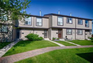 Photo 1: 33 3029 RUNDLESON Road NE in Calgary: Rundle Row/Townhouse for sale : MLS®# C4192405