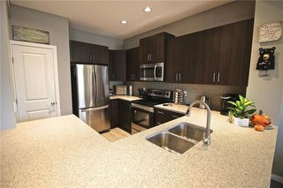 Photo 7: 271 RIVER HEIGHTS Crescent: Cochrane Detached for sale : MLS®# C4214188