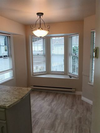 """Photo 2: 45 6537 138 Street in Surrey: East Newton Townhouse for sale in """"CHARLESTON GREEN"""" : MLS®# R2325930"""