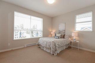 "Photo 16: 404 6480 194 Street in Surrey: Clayton Condo for sale in ""WATERSTONE - ESPLANADE"" (Cloverdale)  : MLS®# R2330843"