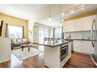 """Photo 2: 407 15850 26 Avenue in Surrey: Grandview Surrey Condo for sale in """"THE SUMMIT HOUSE"""" (South Surrey White Rock)  : MLS®# R2444277"""