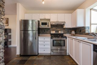 "Photo 12: 404 33478 ROBERTS Avenue in Abbotsford: Central Abbotsford Condo for sale in ""Aspen Creek"" : MLS®# R2469607"