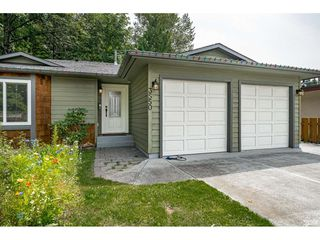 Photo 1: 3550 PEARKES Place in Port Coquitlam: Lincoln Park PQ House for sale : MLS®# R2478465