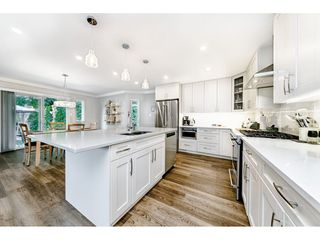 Photo 3: 3550 PEARKES Place in Port Coquitlam: Lincoln Park PQ House for sale : MLS®# R2478465