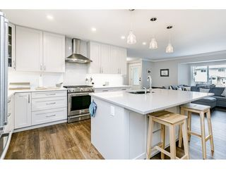 Photo 2: 3550 PEARKES Place in Port Coquitlam: Lincoln Park PQ House for sale : MLS®# R2478465